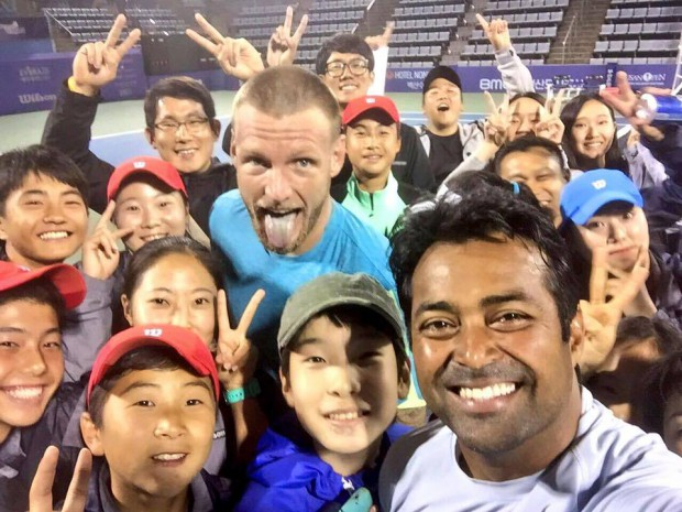 Paes and Sam Groth with kids