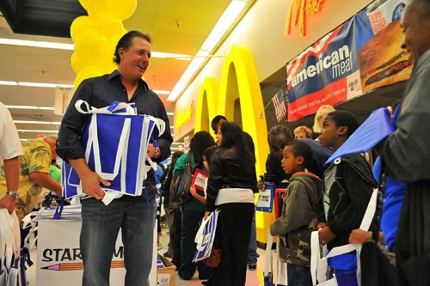 Phil Mickelson greets Wal-Mart shoppers at a back-to-school shopping spree