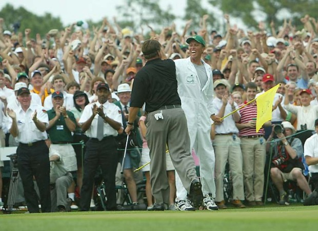 Phil Mickelson celebrates with his caddie Jim