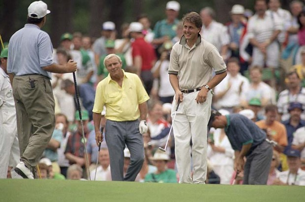 Young Phil Mickelson practices with Arnold Palmer and Rocco Mediate during practice for the 1991 Masters