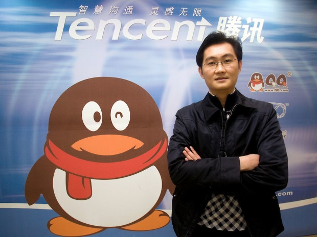 CEO of Tencent Holding Ltd Ma Huateng poses next to the company logo in the headquarters