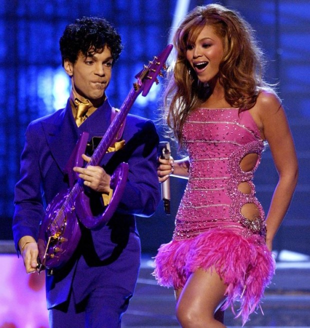 Beyonce Knowles performing with Prince