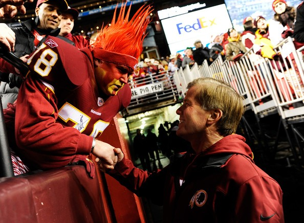 Virginia Governor Bob McDonnell greets a Washington Redskins fans prior to their game
