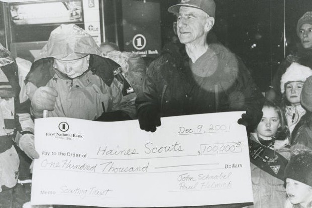 John Donating Money to the Boys Scouts in 2001