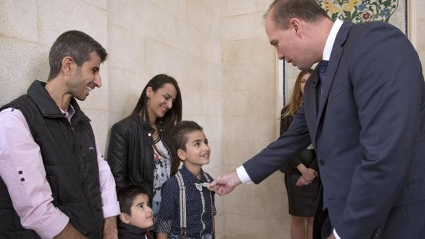 Peter Dutton during his visit to Jordan with one of the Refugee Families