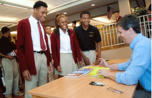 Jeff Signing to Students at Bishop McNamara High School
