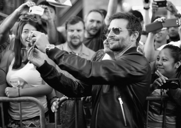 Bradley Cooper taking selfie at event of Guardians of the Galaxy
