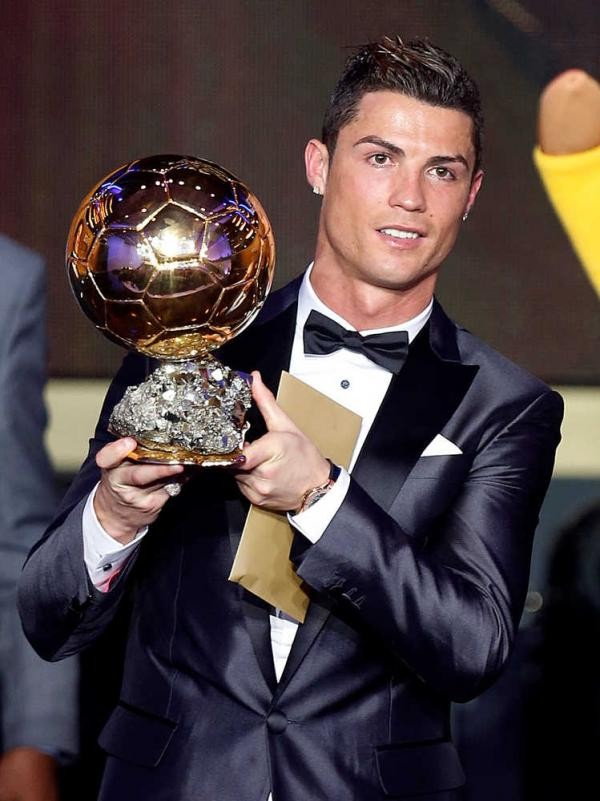 Cristiano with World Player of the Year Trophy