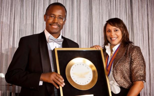 Poet Natasha Trethewey receives the Golden Plate from Benjamin Carson