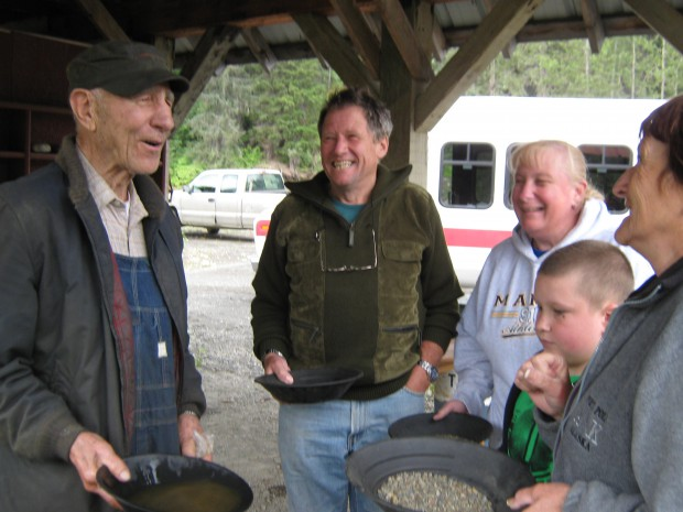 Johns Schnabel with Some of the Visitors and John Explaining Panning of Gold