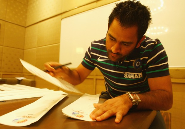 Dhoni Busy with His Paper Work