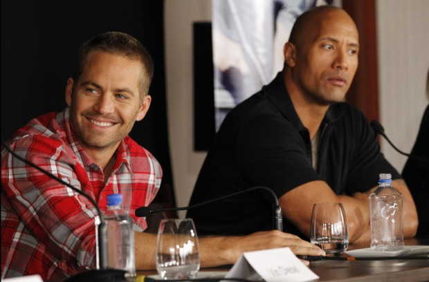 Paul Walker with Dwayne Johnson during Fast and Furious Press Meet