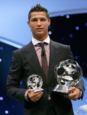Ronaldo Holding His PFA Player of The Year Awards