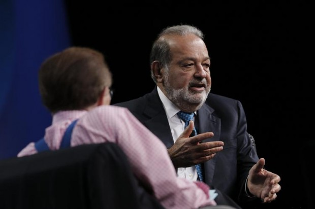 Carlos Slim Helu is interviewed by Larry King during the Milken Institute Global Conference