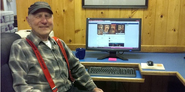 John Using His Facebook in His PC
