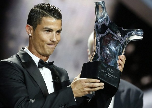 Cristiano Showing His UEFA Best Player of Europe Award