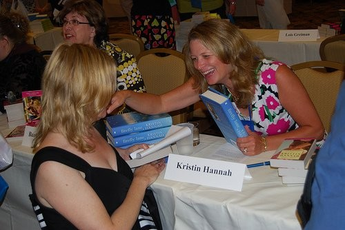 Kristin Hannah signs a book for Grace d'Otare at the Readers for Life Literacy Signing at the RWA conference