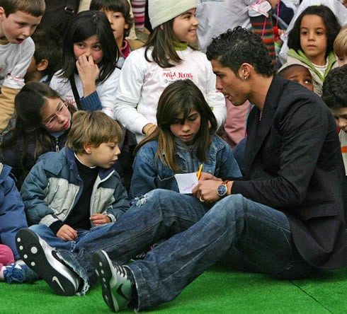 Ronaldo Signing to His Kid Fans at Charity Event