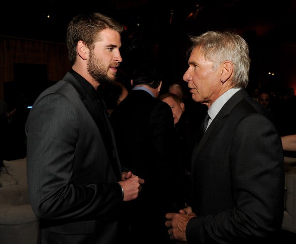 Harrison Ford talking with Liam Hemsworth at Paranoia Event