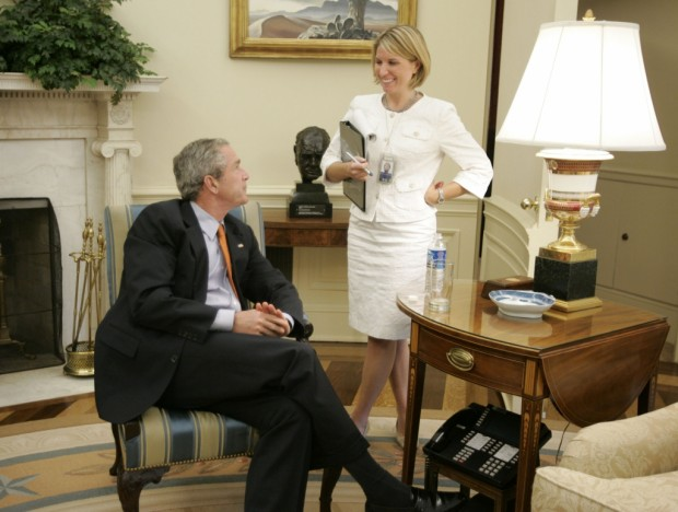 Nicolle Wallace with President George W. Bush in the Oval Office