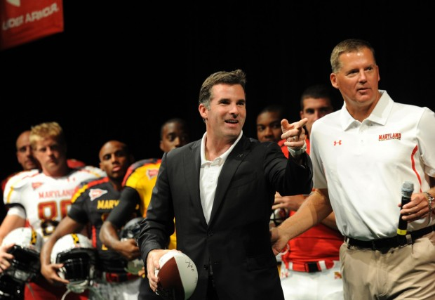 Kevin Plank stands by Randy Edsall