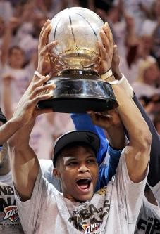 Russell Westbrook raising the Western Conference championship trophy