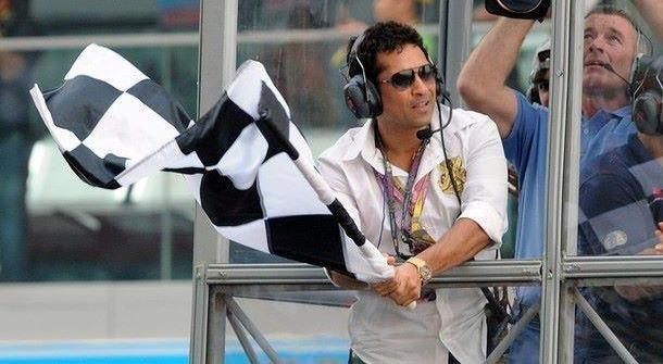 Sachin Tendulkar waving the Checkered Flag at Indain Grand Prix 2011