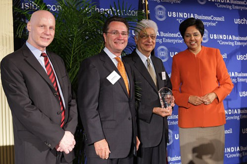 Aziz Premji receiving award from Indra Nooyi.