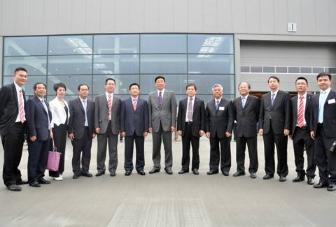 Sany Group Chairman Liang Wengen with his Partners