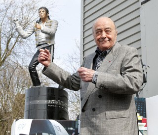 Mohamed Al Fayed poses after unveiling a statue of Michael Jackson