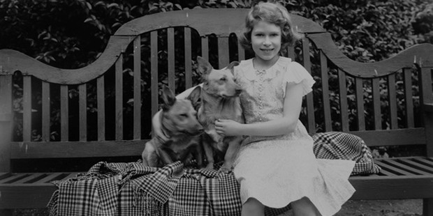 Elizabeth with two of her childhood pet corgis in July 1936