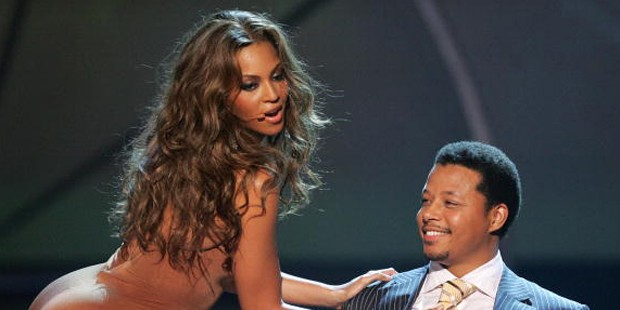 Terrence Howard with Beyonce Perform onstage at the BET Awards