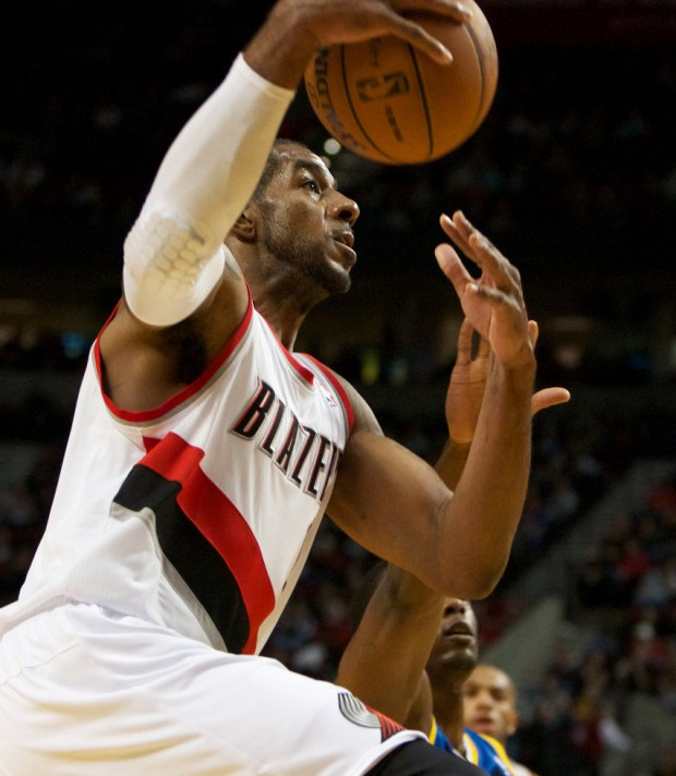 Portland Trail Blazers drives to the basket against the Golden State Warriors at the Rose Garden