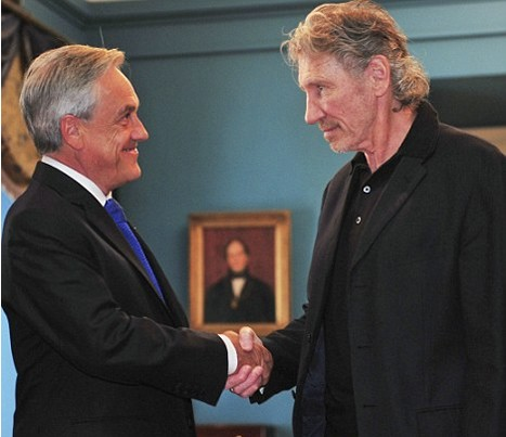 Ex Pink Floyd bassist and singer Roger Waters, right, shakes hands with Sebastian Pinera