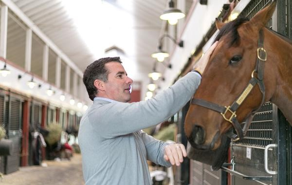 Kevin Plank with Polyester, a three-year-old filly at Sagamore Farm