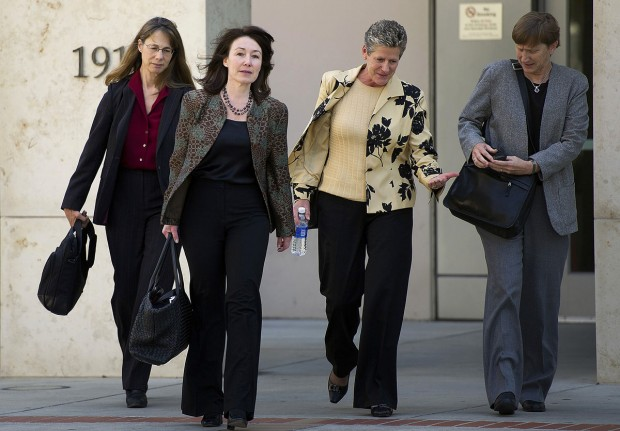 Safra A. Catz Walking Out Of Office With Team Members