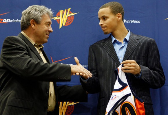 Stephen Curry, left, with Larry Riley