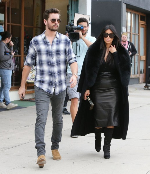 Kim Kardashian walking with Scott Disick