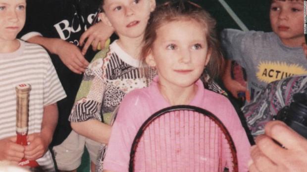 Childhood Photo of Azarenka Holding a Tennis Rocket
