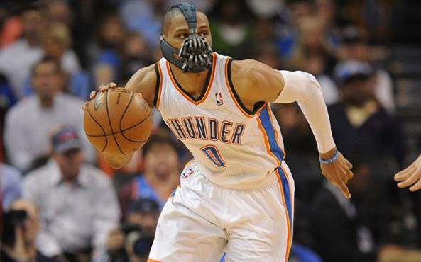 Russell Westbrook playing basketball wearing a face mask