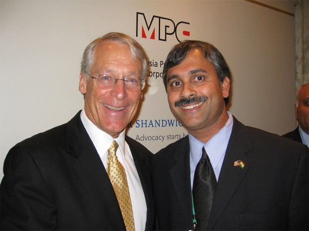 Robson Walton with Mike Singh