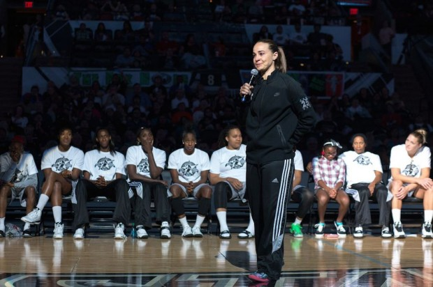 Becky Hammon is congratulated by the Minnesota Lynx Team