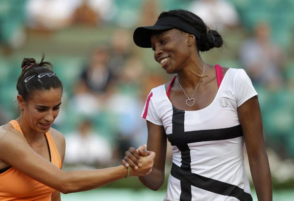 Venus Williams of the US shakes hands with Paula Ormaechea of Argentina