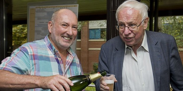 Stephen West (L), Deputy Director of Clare Hall pours Swedens Tomas Lindahl