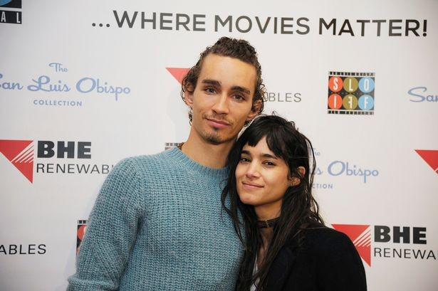Robert Sheehan with Sofia Boutella