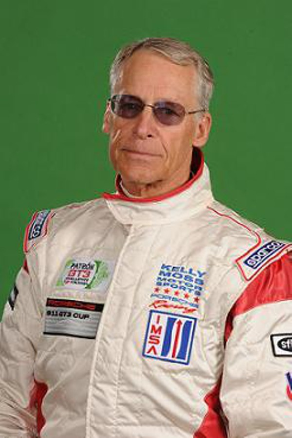Robson Walton in a racer outfits