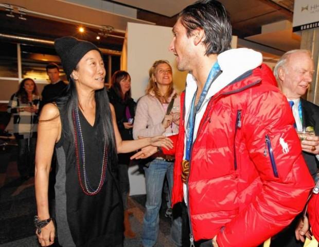 Vera Wang (l.) greets Evan Lysace