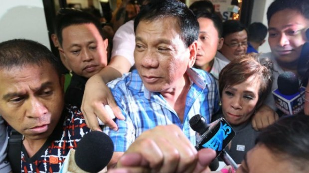 Davao City Mayor Rodrigo Duterte arrives at the Comelec office in Manila