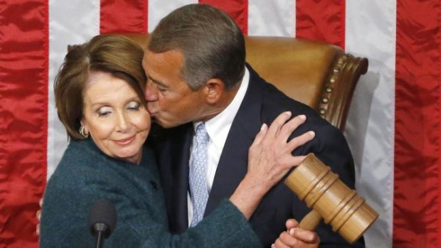 Congressman John Boehner (R-Ohio) kisses House Minority Leader Nancy Pelosi