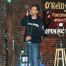 Crowe singing at O'Reilly's Pub